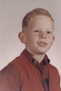 Scott Gordon as a red-haired boy